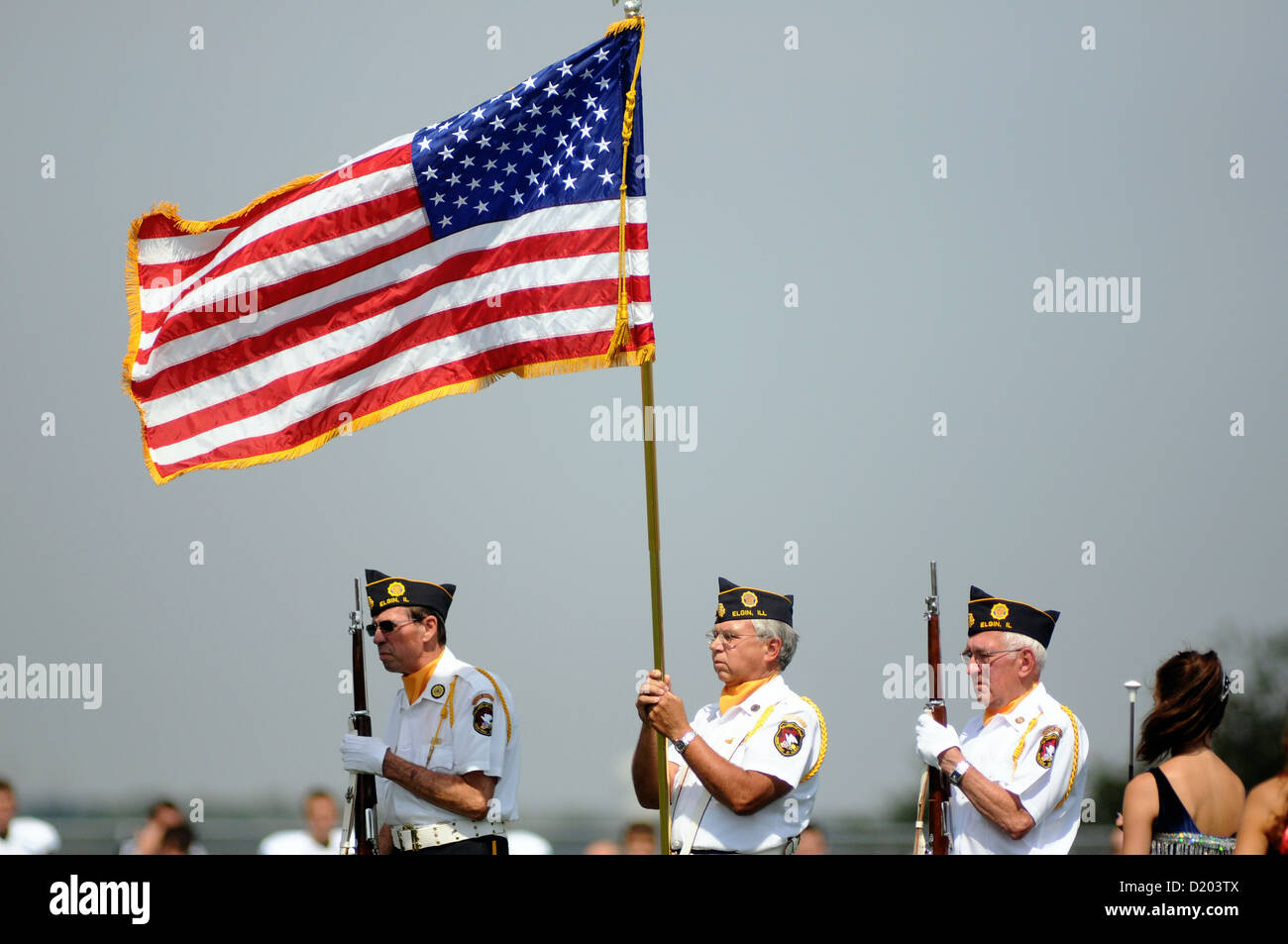 Honor guard displays colors during playing of the 'National Anthem' prior to the start of a high school - Stock Image