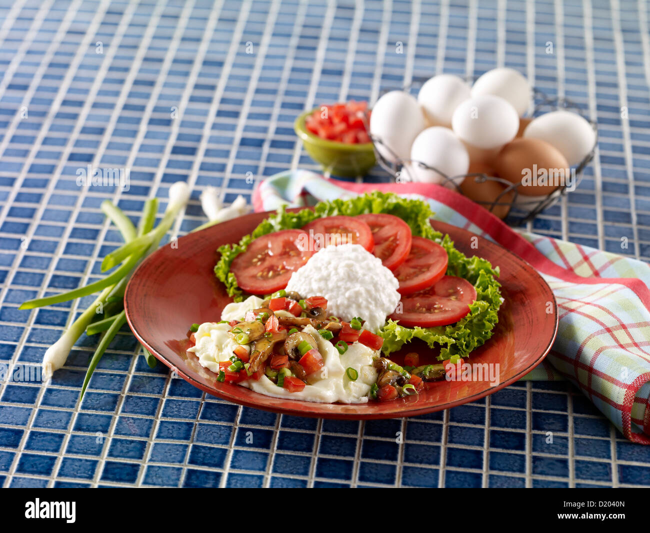 Egg white scramble with cottage cheese and tomatoes Stock Photo