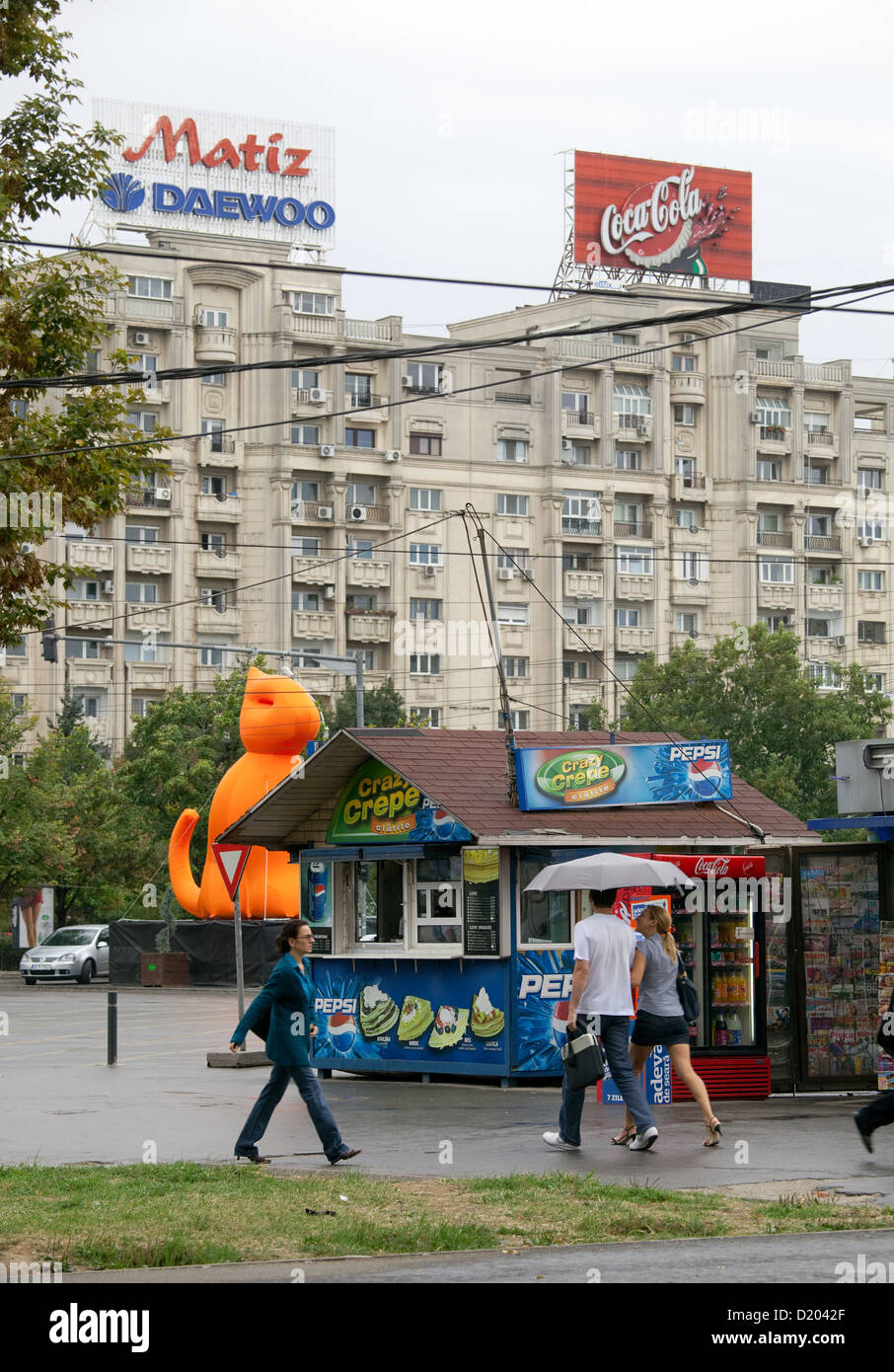 Bucharest, Romania, passers-by and a kiosk at the grounds of the unit - Stock Image