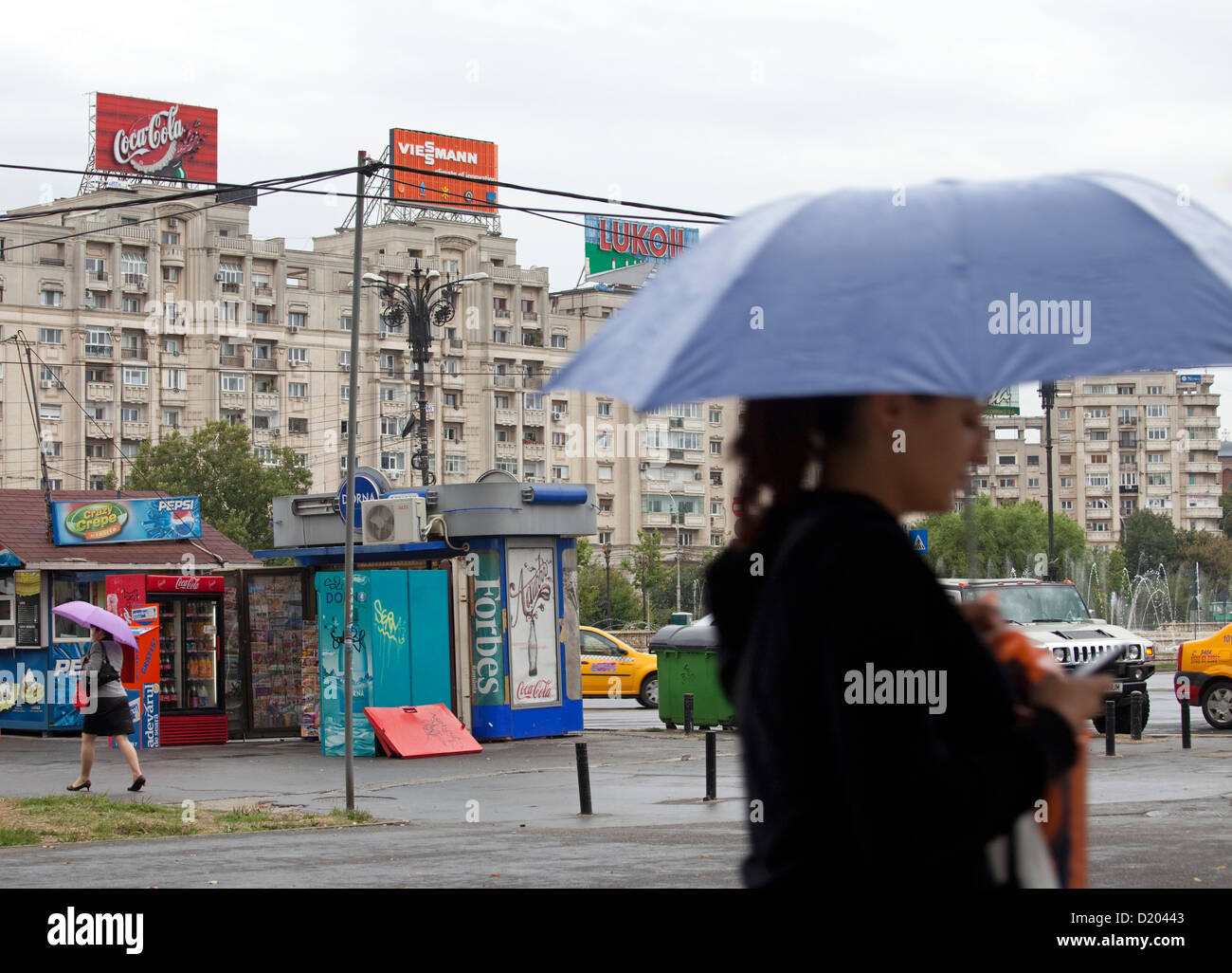 Bucharest, Romania, and passers-houses with billboards in place of the unit - Stock Image