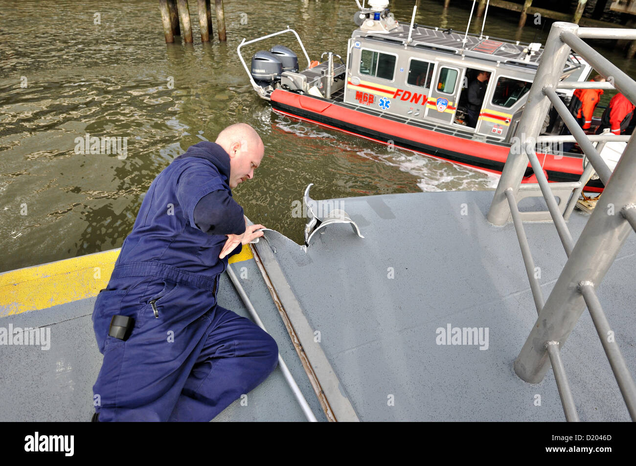 New York, USA. 9th January 2013. US Coast Guard Maritime inspectors examine the Seastreak Ferry after it slammed - Stock Image