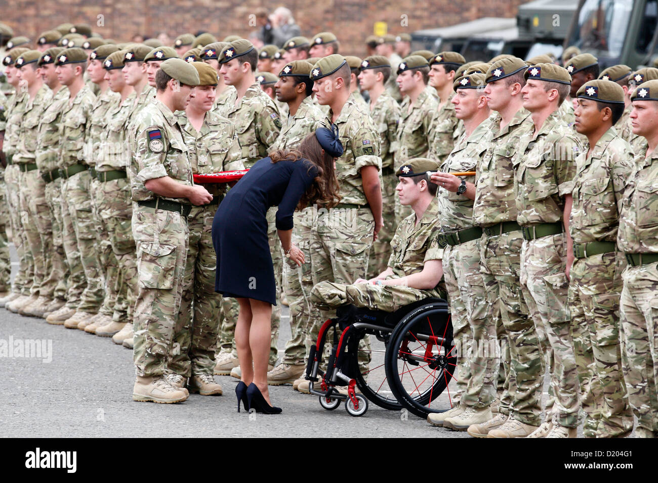 The Duchess of Cambridge, Kate Middleton, hands out operational medals to soldiers from 1st Battalion Irish Guards. Stock Photo