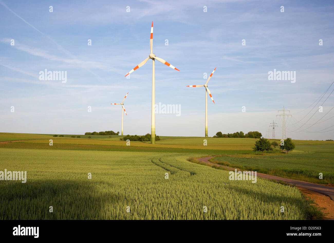 Agricultural landscape with wind wheels near Bueschdorf, Saarland, Germany, Europe - Stock Image