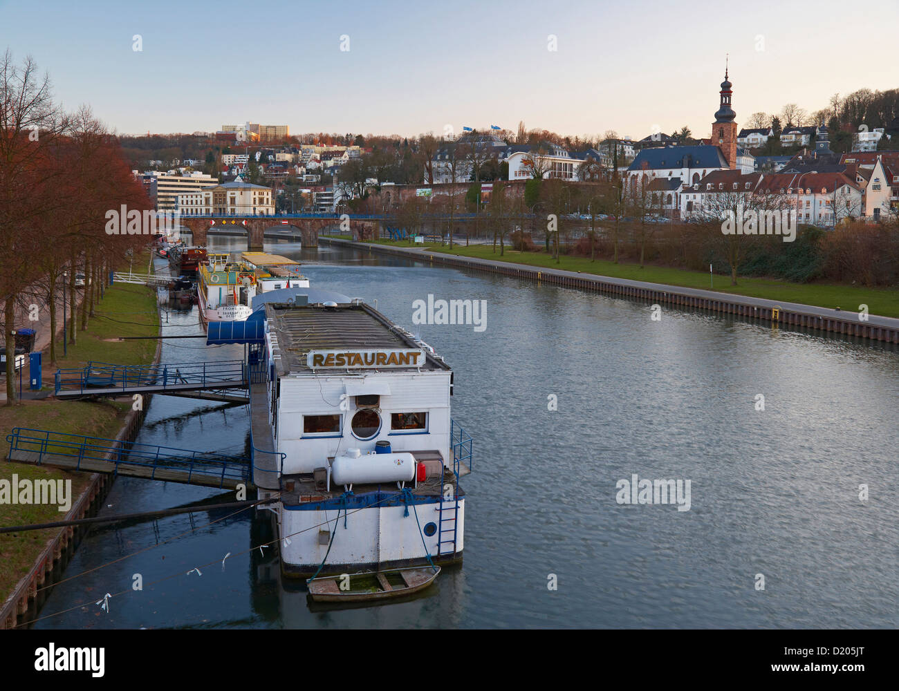View of the river Saar with Alte Bruecke, Provincial diet, Landtag, castle and castle church in the evening, Saarbruecken, - Stock Image