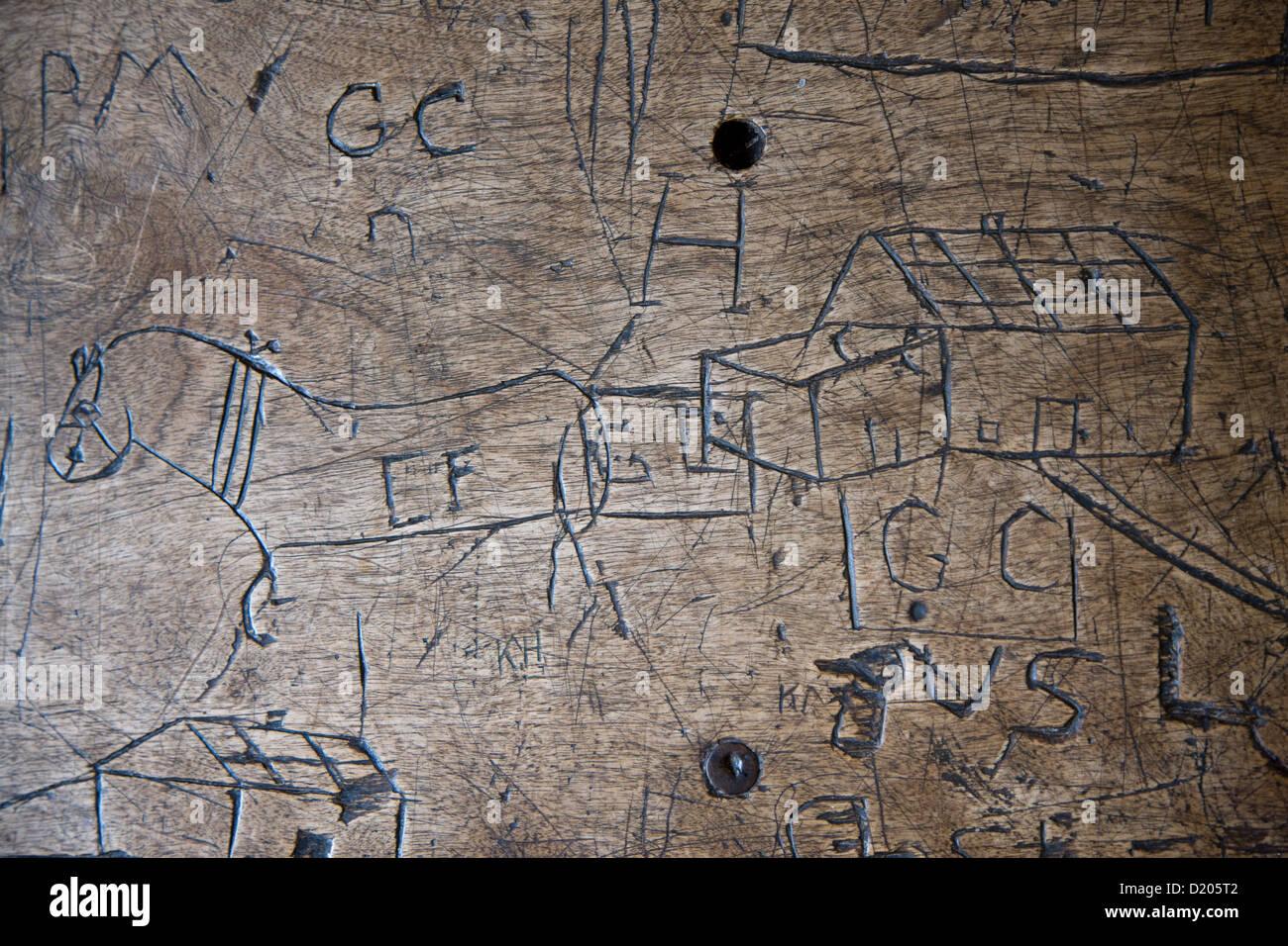 Desk graffiti in the classroo of the school in Orwell ...
