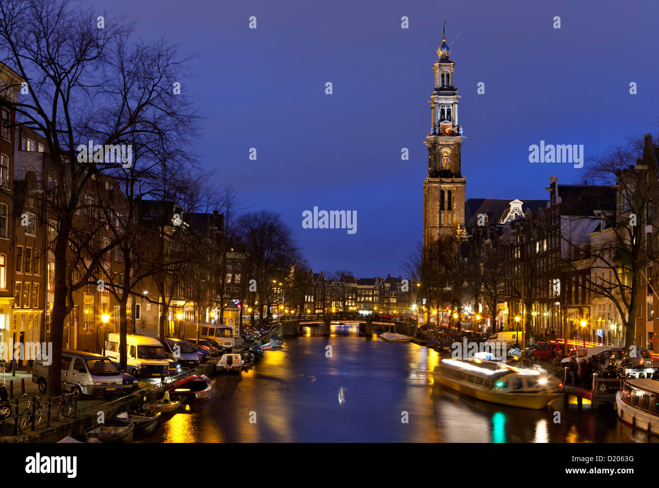 Westerkerk church tower on Prinsengracht at night, Amsterdam, Netherlands - Stock Image