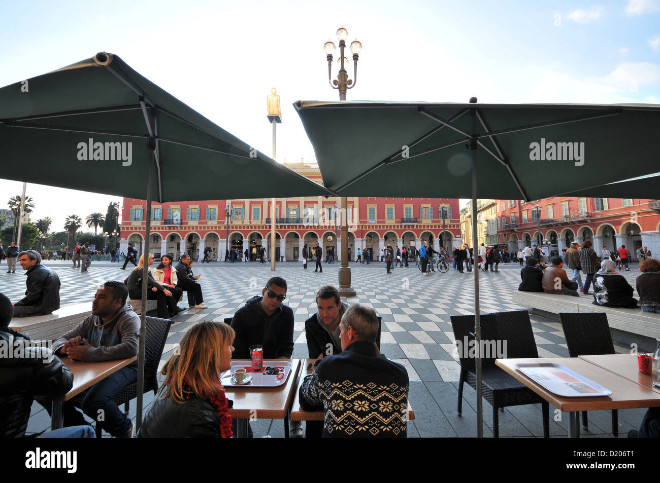 People in a cafe at Place Massena, Nice, Cote d'Azur, South France, Europe - Stock Image