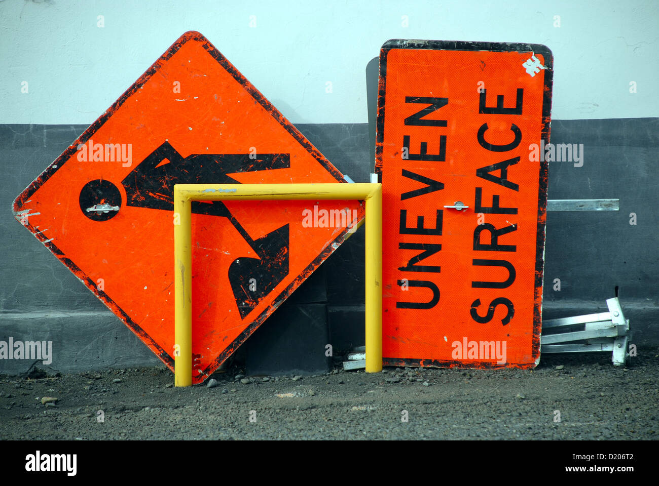 Humourous uneven surface sign - Stock Image