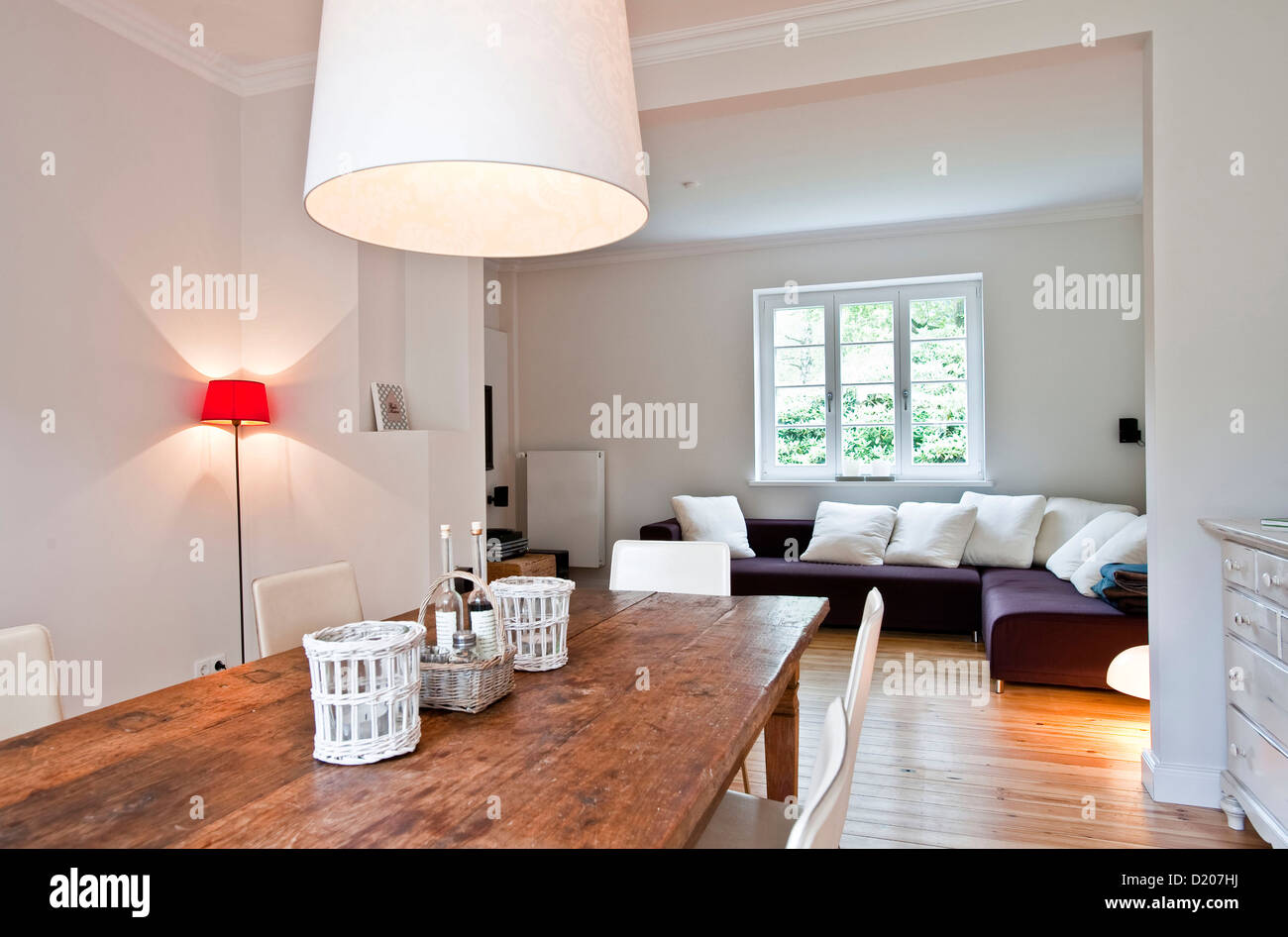 View from dining table towards the lounge, House furnished in country style, Hamburg, Germany - Stock Image
