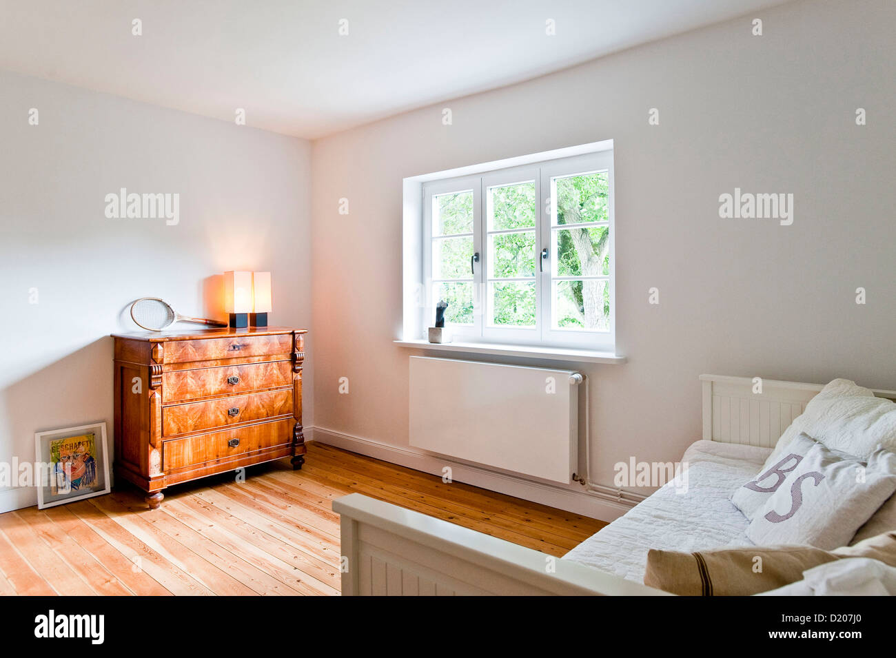 Bedroom with Bed and chest of drawers, House furnished in country style, Hamburg, Germany - Stock Image