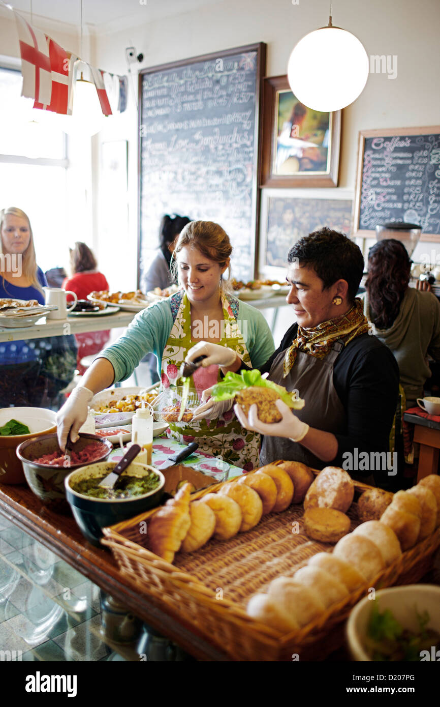 People inside of Deli The Kitchen, owned by Karen Dudley, Woodstock, Cape Town, South Africa, Africa - Stock Image