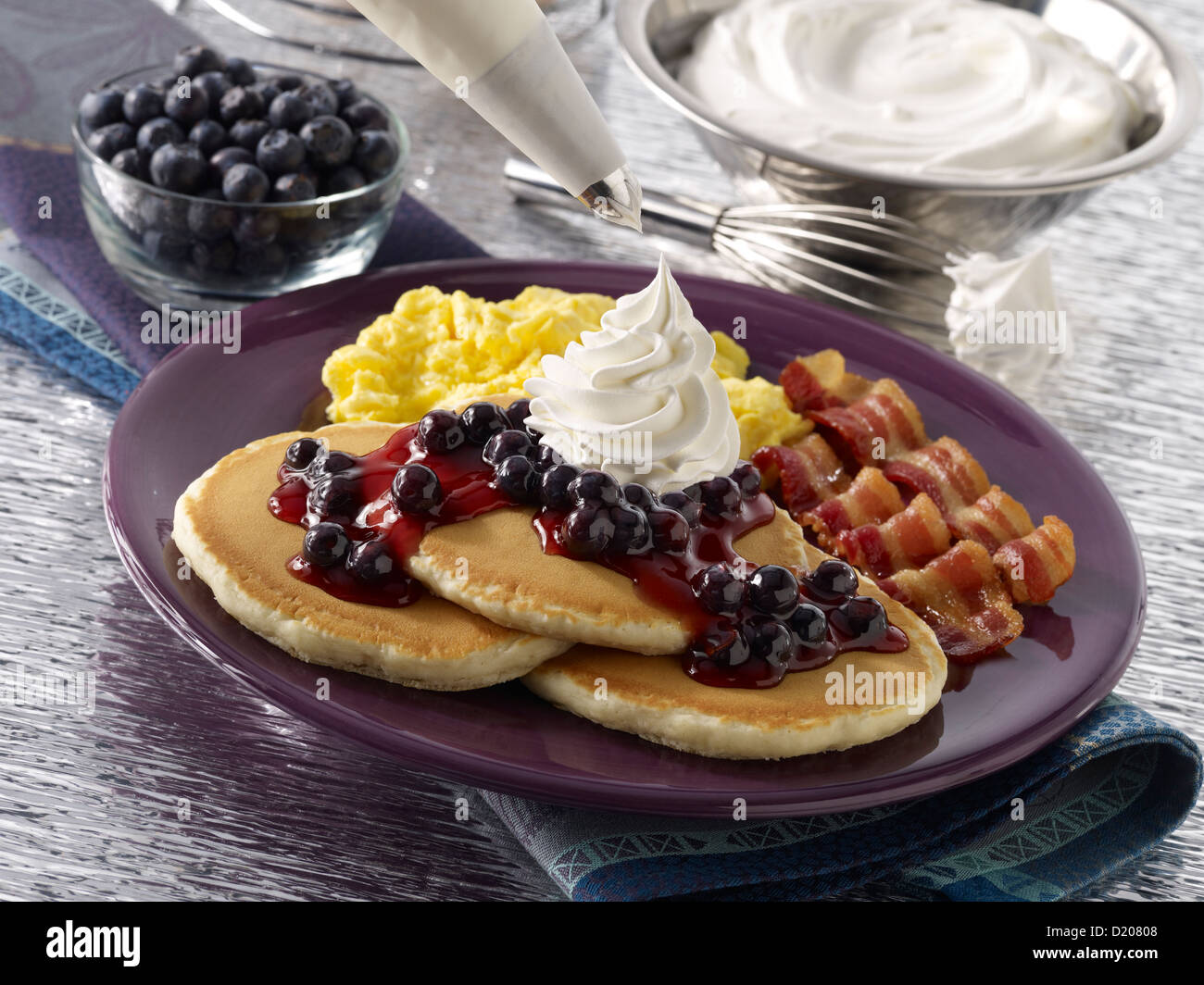 Blueberry Pancakes with Whipped Cream - Stock Image