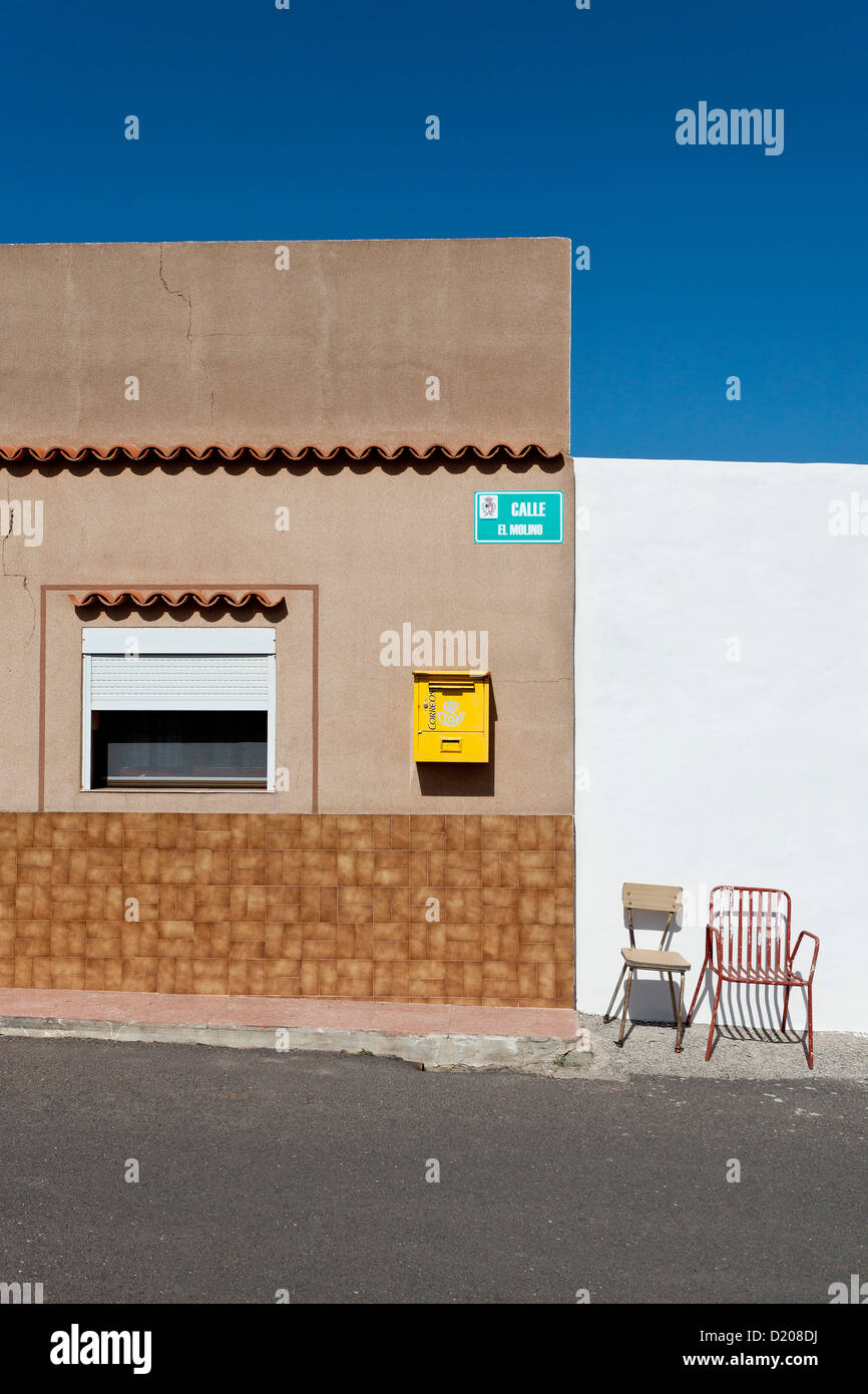 Letter box and chairs in front of a house, Antigua, Fuerteventura, Canary Islands, Spain - Stock Image
