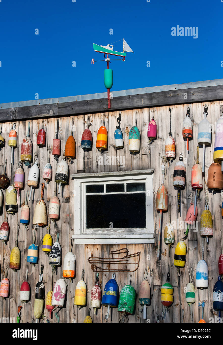 Lobster shack with colorful buoys, Jonesport, Maine, USA - Stock Image