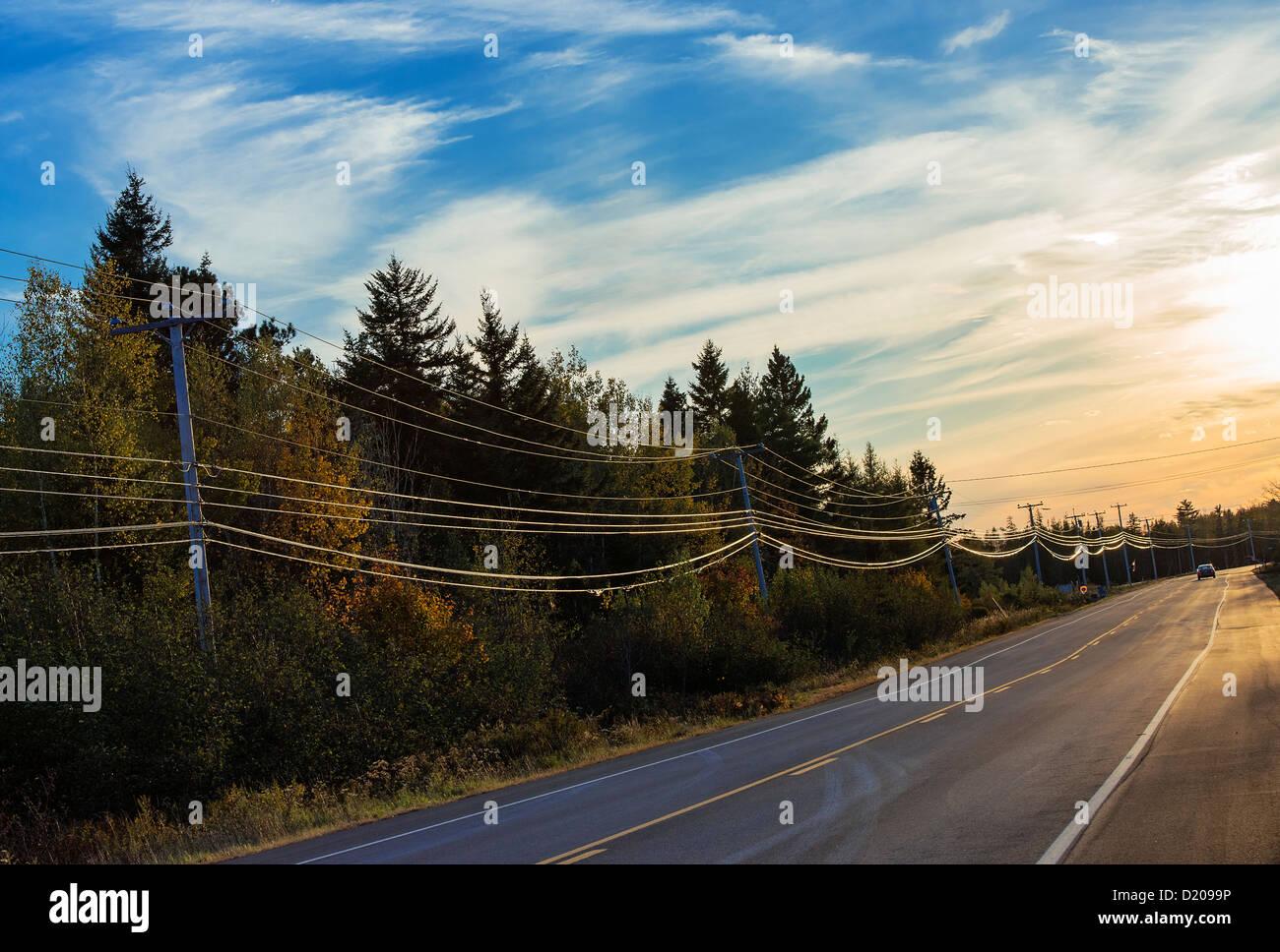 Rural highway, Maine, USA - Stock Image