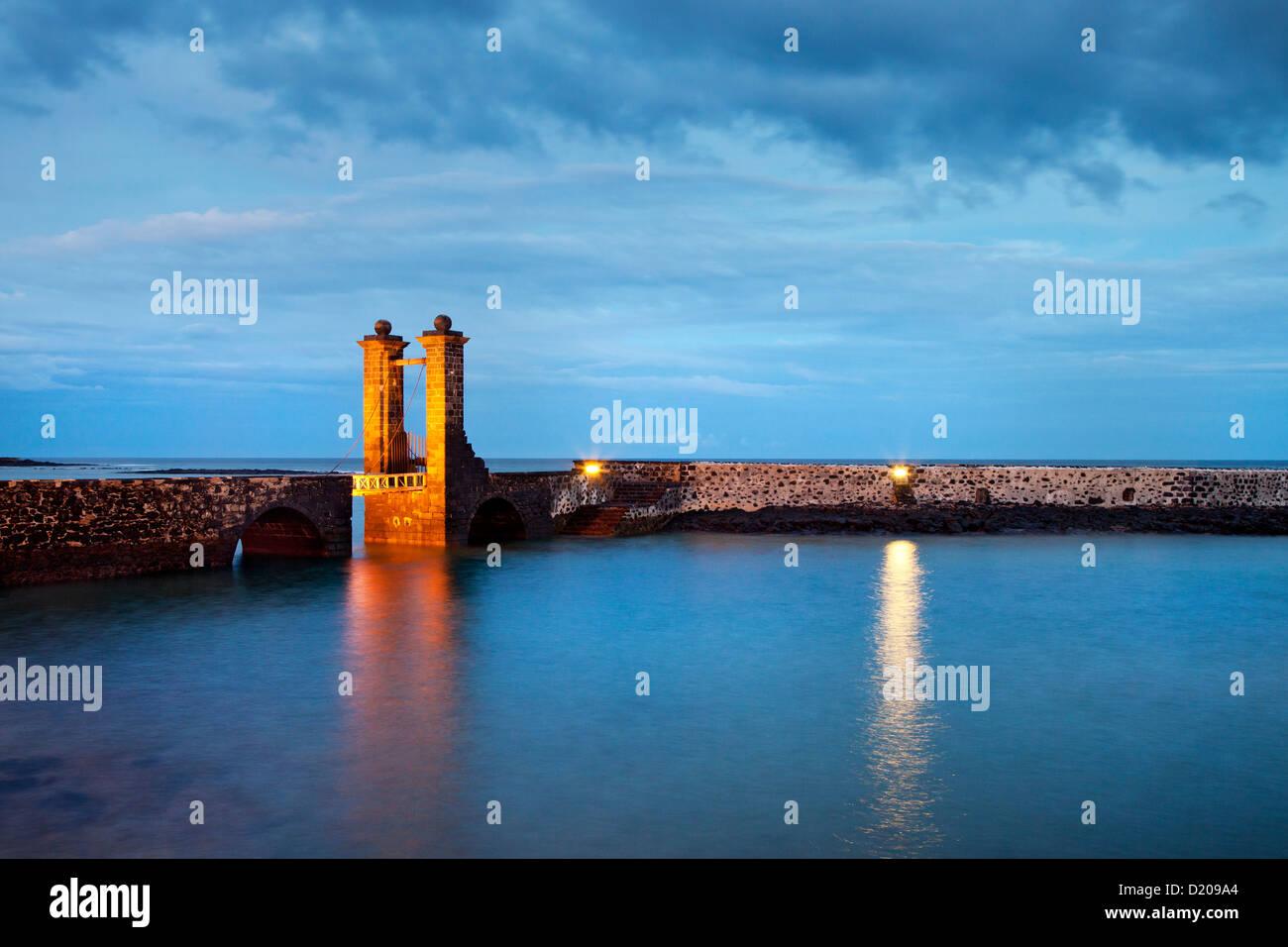 Illuminated bridge, Puente de las Bolas in the evening, Arrecife, Lanzarote, Canary Islands, Spain, Europe Stock Photo