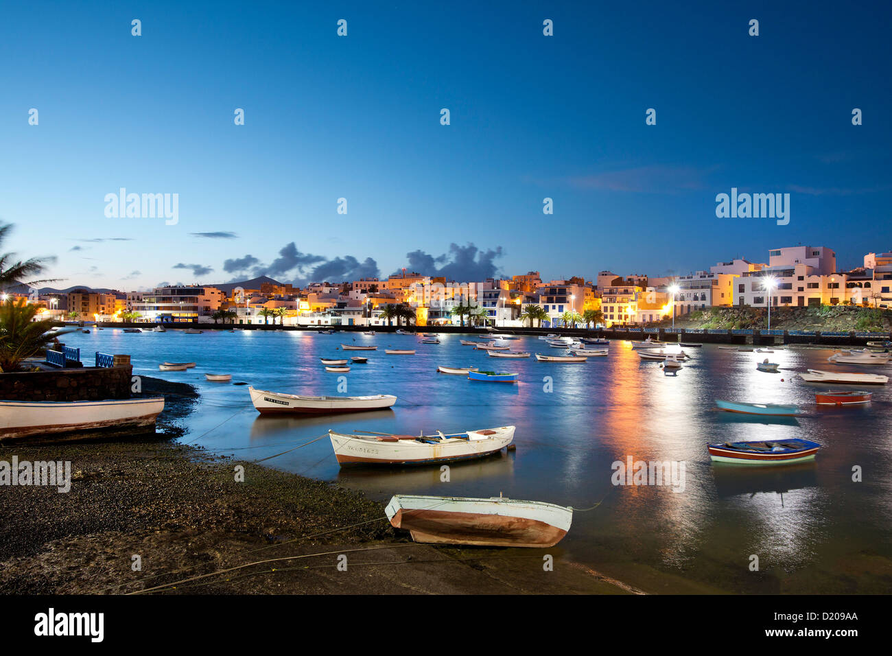 Illuminated houses at Charco de San Gines in the evening, Arrecife, Lanzarote, Canary Islands, Spain, Europe - Stock Image