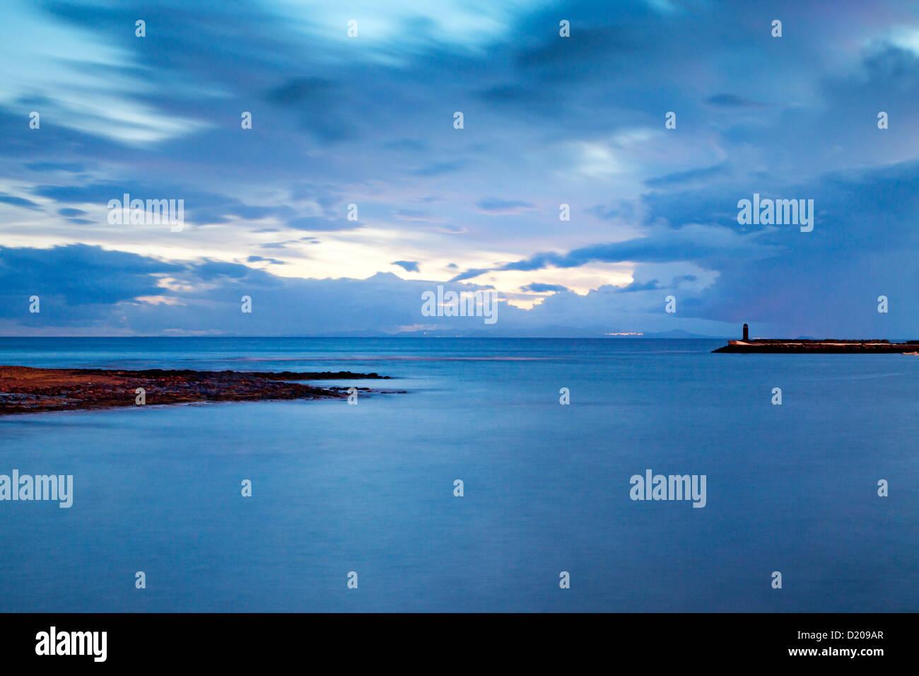 Sea at dusk, Arrecife, Lanzarote, Canary Islands, Spain, Europe - Stock Image
