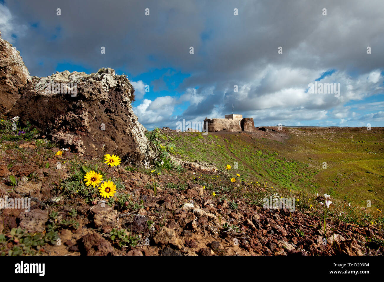 Castillo de Santa Barbara under clouded sky, Teguise, Lanzarote, Canary Islands, Spain, Europe - Stock Image