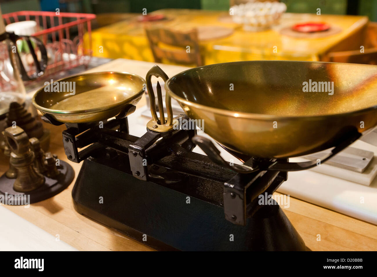 Antique balance scale in kitchen - Stock Image