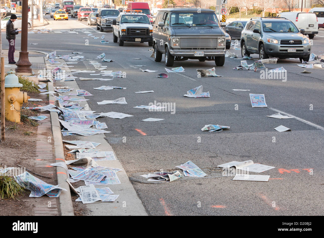 Road littered with newspapers - USA - Stock Image