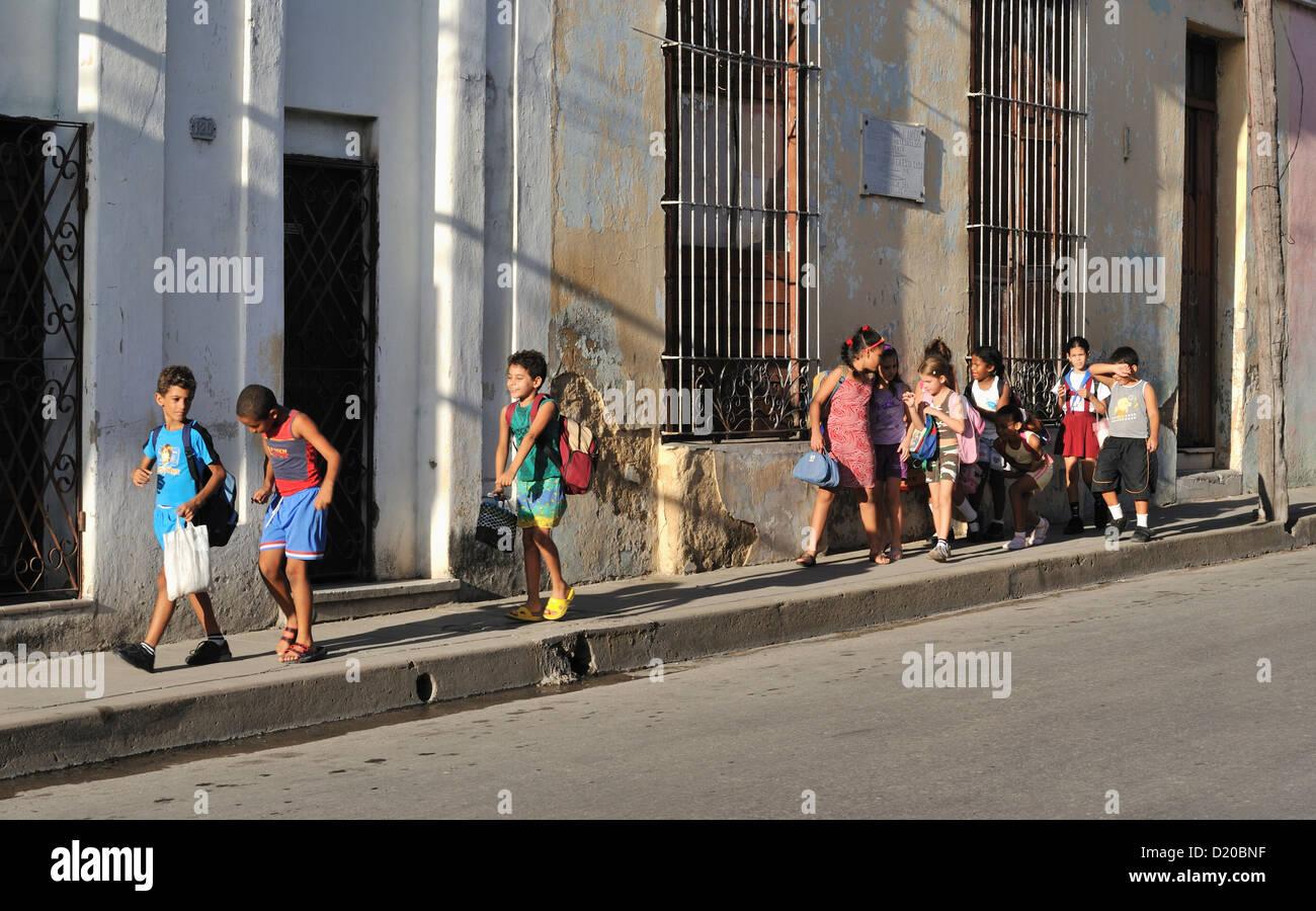 Schoolchildren on the way from school, Santa Clara, Cuba - Stock Image