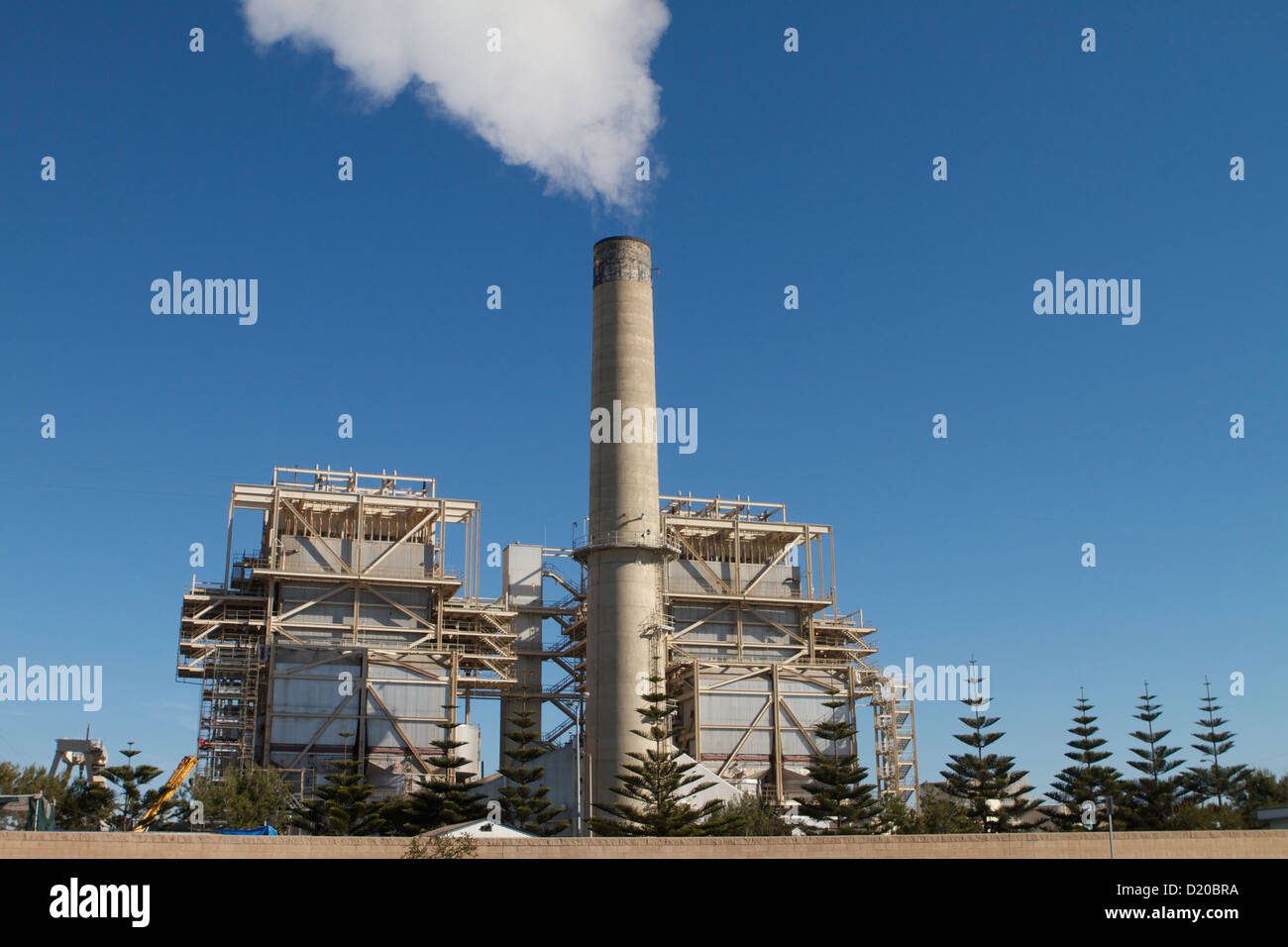 AES Huntington Beach Generating power Station with steam rising from one of its stacks - Stock Image