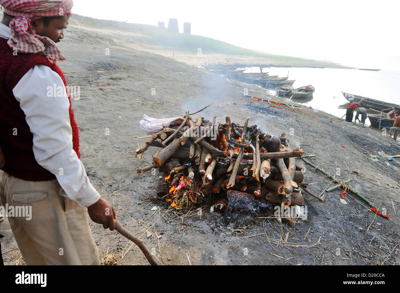 A cremation on the banks of the Ganges in India. - Stock Image