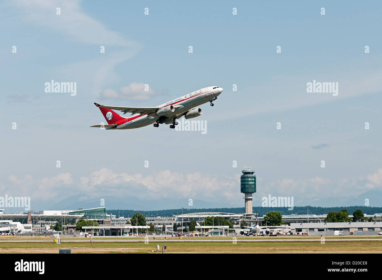 A Sichuan Airlines Airbus A330-200 jetliner departs from Vancouver International Airport - Stock Image