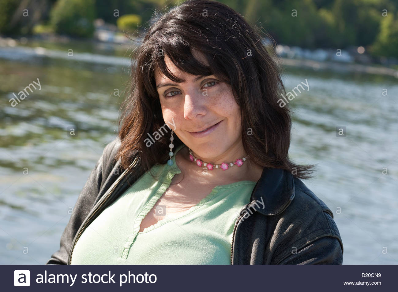 Beguiling Smile From A Dark Haired Full Figured Attractive Woman