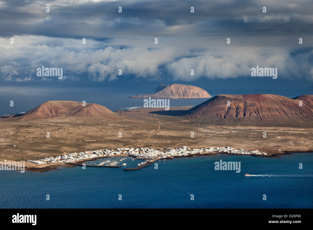 View of the island of La Graciosa under clouded sky, Lanzarote, Canary Islands, Spain, Europe - Stock Image