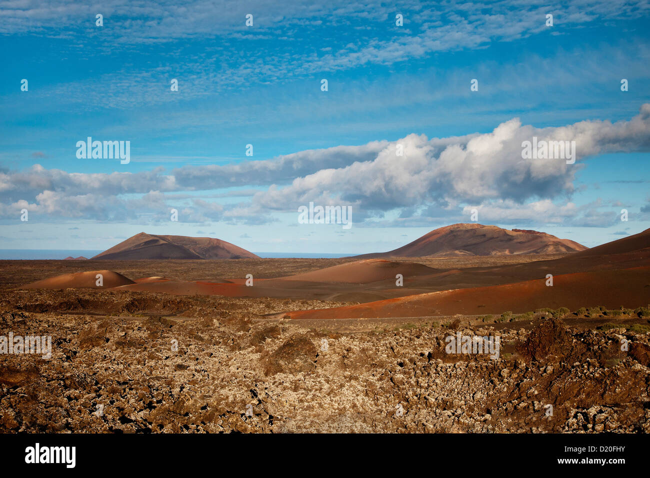 Volcanic landscape under clouded sky, Timanfaya National Park, Lanzarote, Canary Islands, Spain, Europe - Stock Image