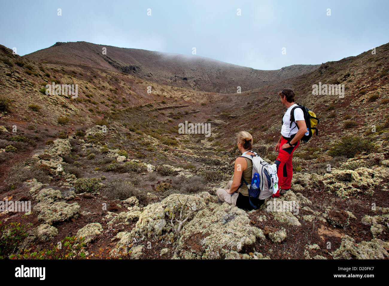 Hiker on top of volcan Los Helechos, Lanzarote, Canary Islands, Spain, Europe - Stock Image