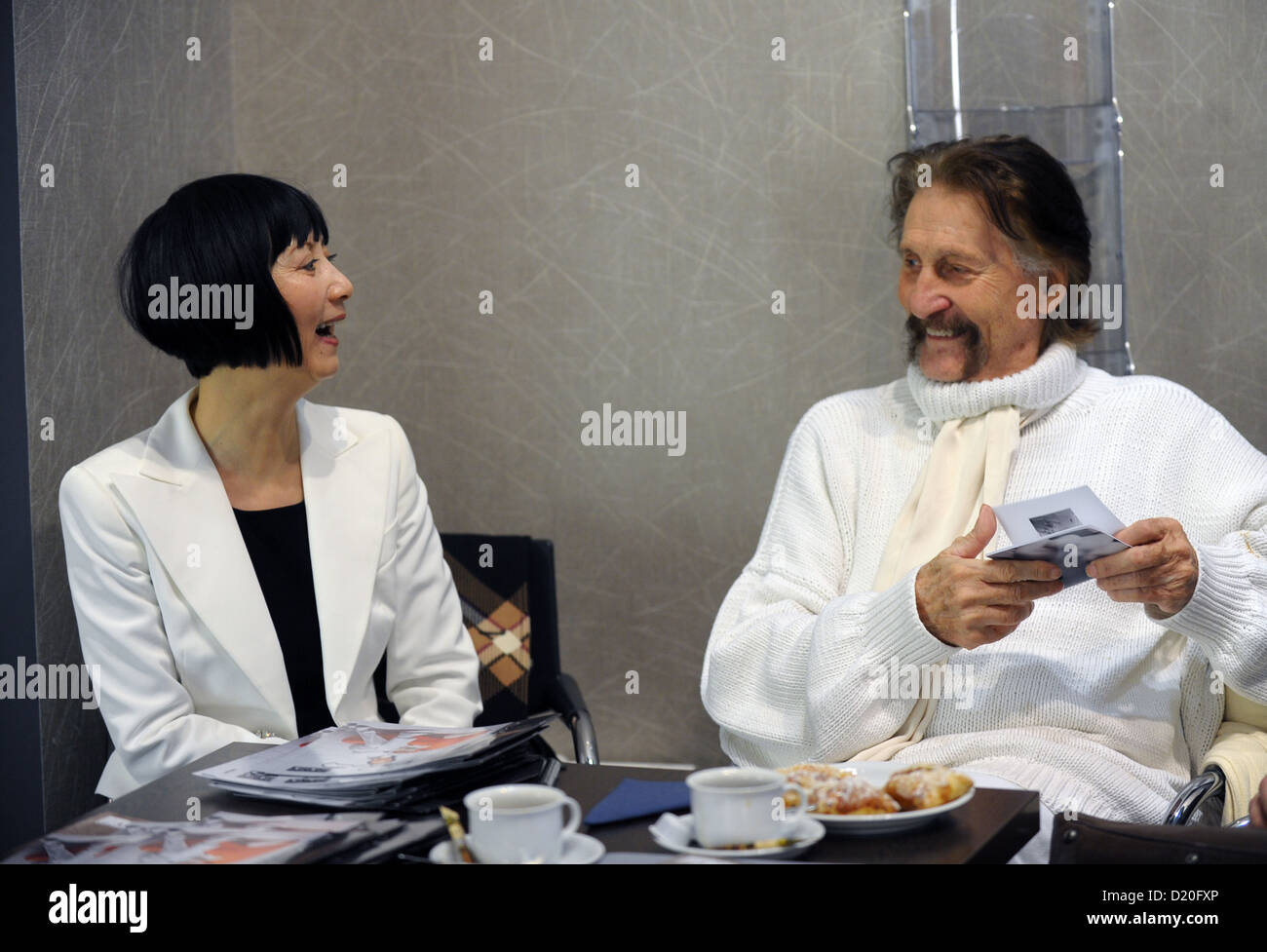 Designer Luigi Colani and his partner Ya-Zhen Zhao smile at trade fair for home and contract textiles 'Heimtextil' - Stock Image