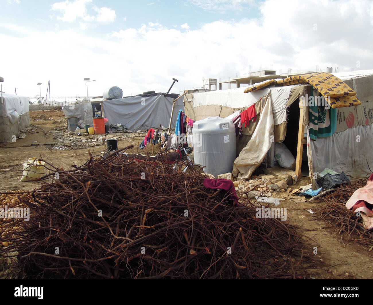 a camp for Syrian refugees near the town zahl in sout lebanon. the baracks are made from tarp over wooden frames. - Stock Image