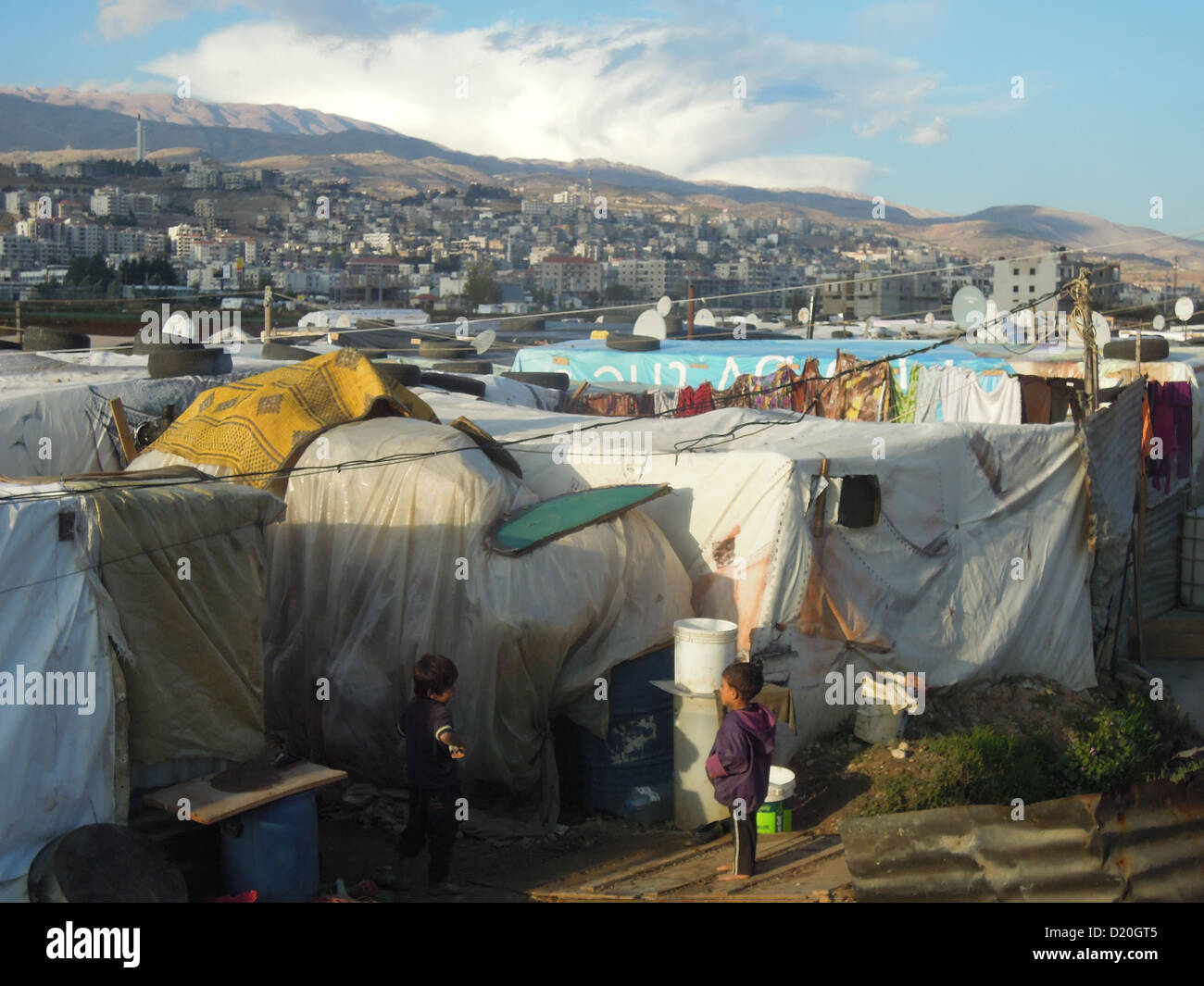 a camp for Syrian refugees near the town zahle in sout lebanon. the baracks are made from tarp over wooden frames. - Stock Image