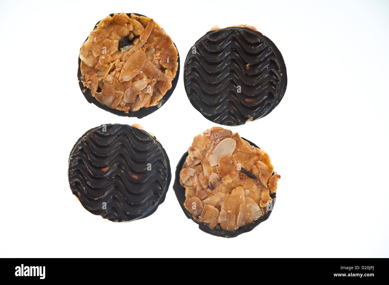 Florentine Biscuits - Belgian dark chocolate base with almond topping. - Stock Image