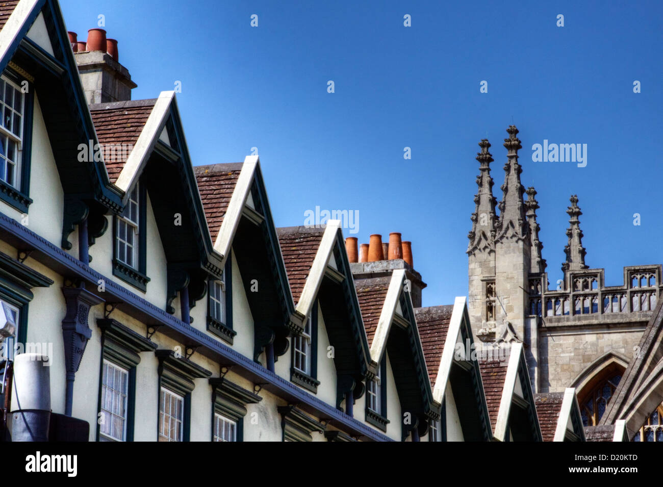 A row of rooftops leading to the Abbey in the City of Bath, Somerset, England, UK - Stock Image