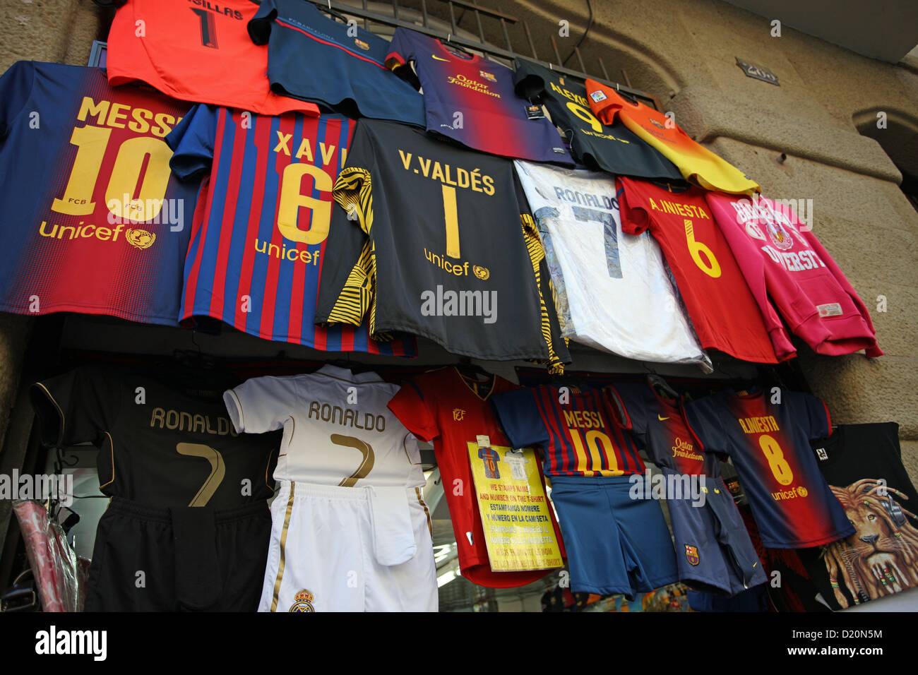 Barcelona Football Club shirts outside a shop in Barcelona Spain - Stock Image