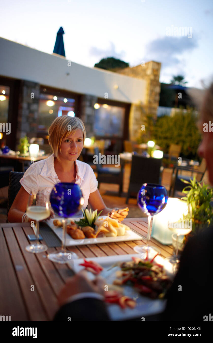 Couple having dinner at restaurant Ariadne, Elounda Beach Resort, Elounda, Crete, Greece Stock Photo