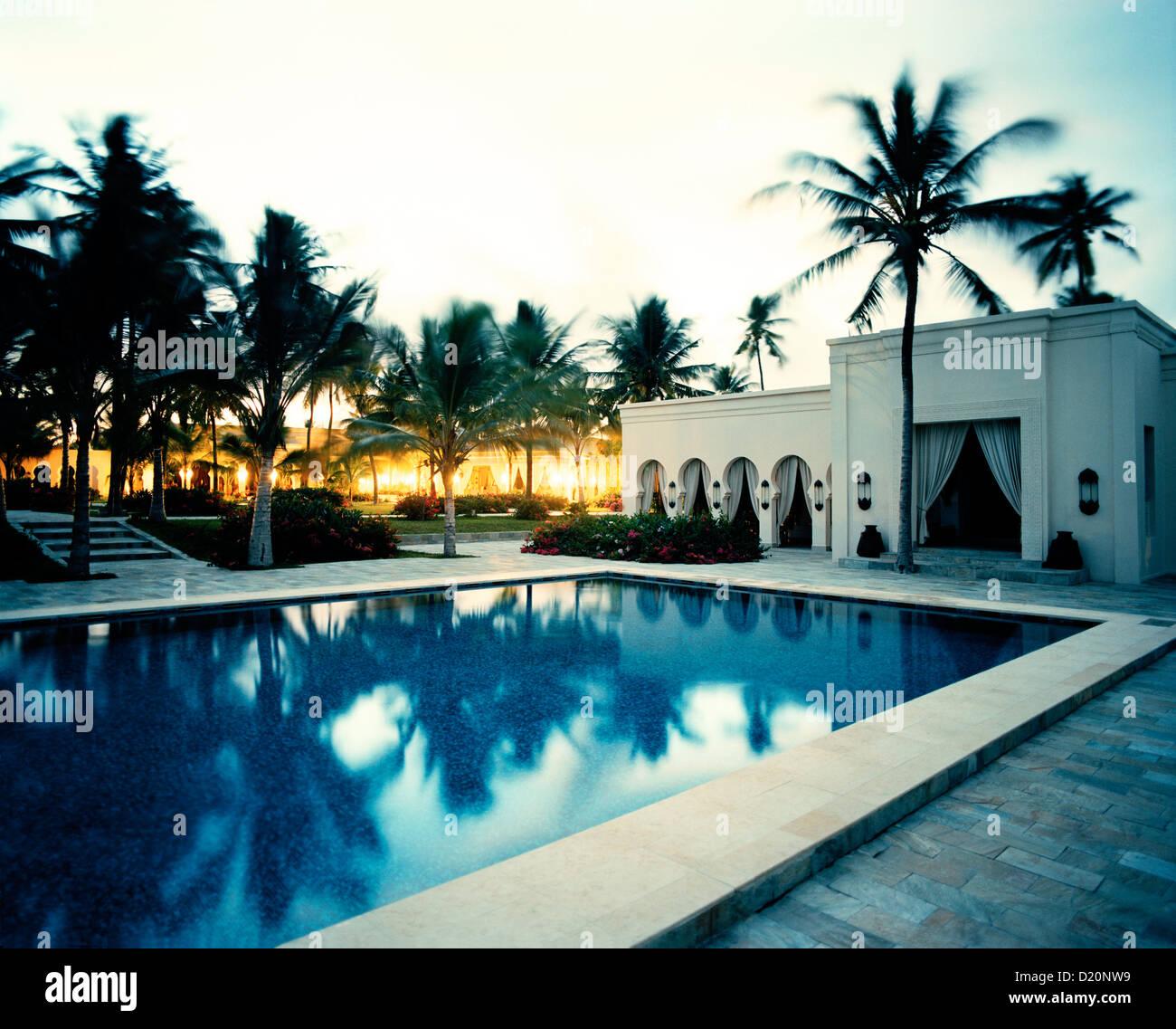 Courtyard with palm trees, Restaurant and Pool of Baraza Spa and Resort in Bwejuu, East Coast, Zanzibar, Tanzania, - Stock Image