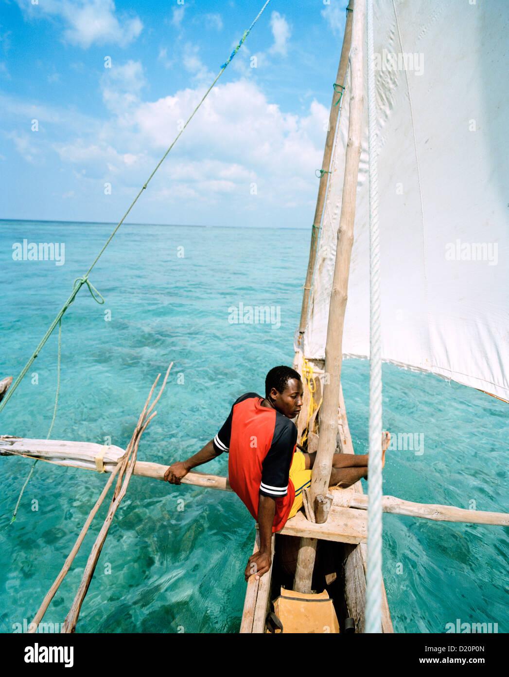 Sailing trip with traditional canoe, near Matemwe village, ahead the north eastern shore, Zanzibar, Tanzania, East - Stock Image