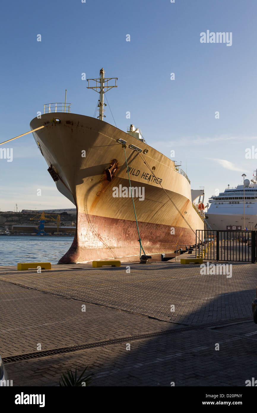 Commercial ship moored Grand Harbour Malta. - Stock Image