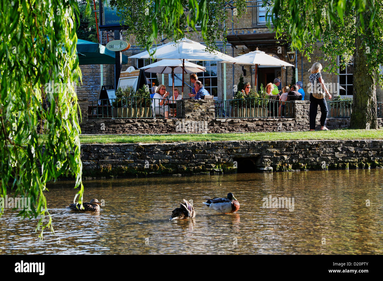 Cafe of the Olde Manse Hotel on the banks of Windrush river, Bourton-on-the-water, Gloucestershire, Cotswolds, England, - Stock Image