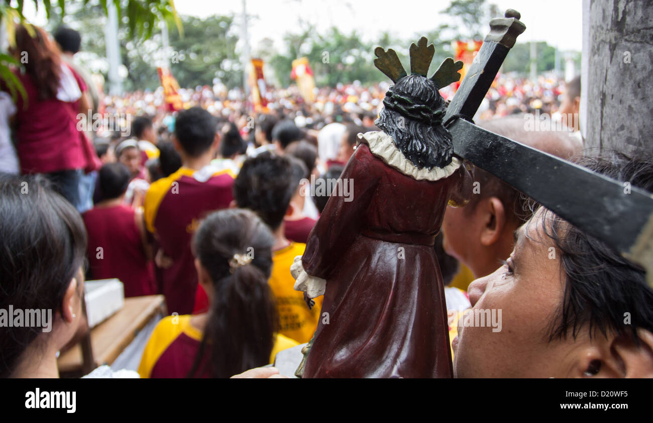 Thousands of Catholic devotees join the procession of the