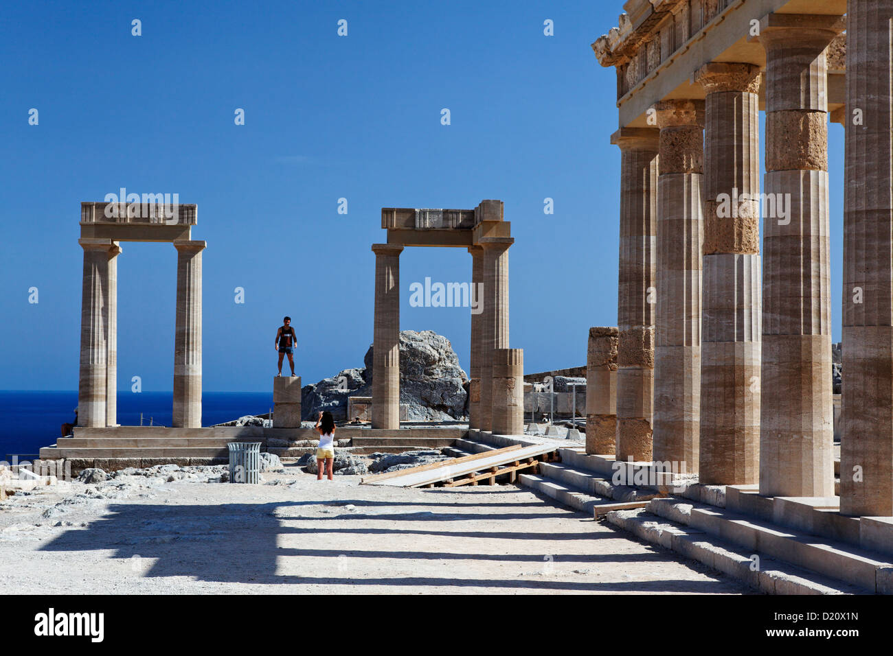 Reconstructed columns of the acropolis, Lindos, Rhodes, Dodecanese Islands, Greece, Europe - Stock Image