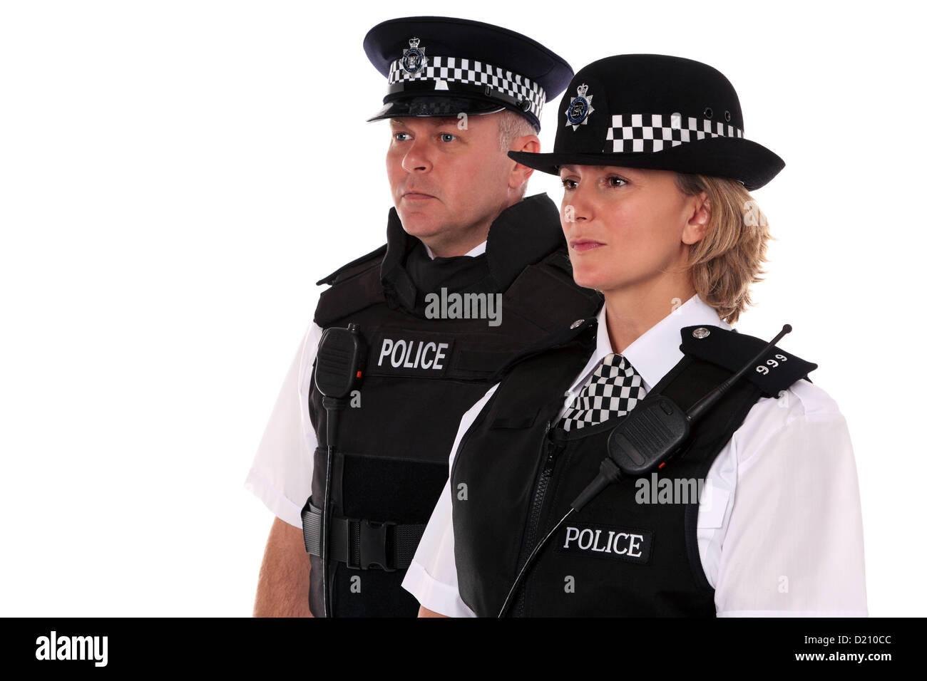 Studio shot of male and female British Police officers in uniform wearing body armour. - Stock Image
