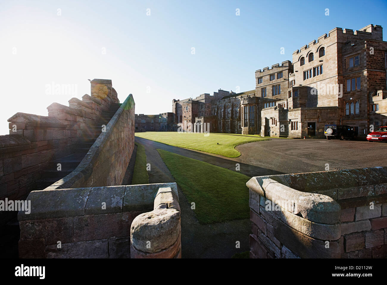 Lawn and driveway in front of Bamburgh Castle, Bamburgh, Northumberland, England, Great Britain, Europe - Stock Image