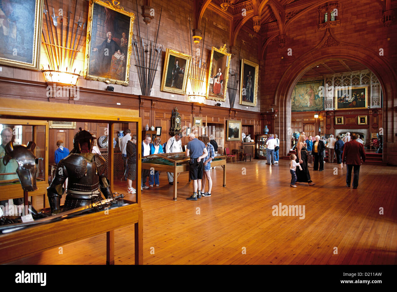Visitors in the exibition at Kings Hall in Bamburgh Castle, Bamburgh, Northumberland, England, Great Britain, Europe - Stock Image