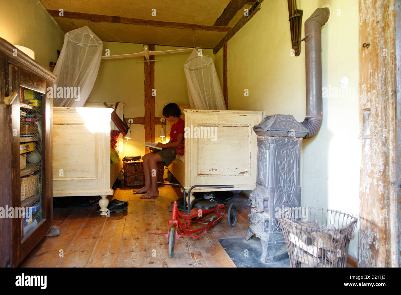 Two children inside children's room, Klein Thurow, Roggendorf, Mecklenburg-Western Pomerania, Germany Stock Photo
